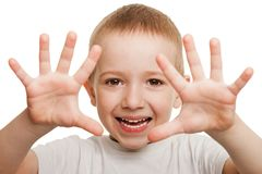 Smiling child gesturing. Little gesturing child boy happiness fun smiling Royalty Free Stock Image