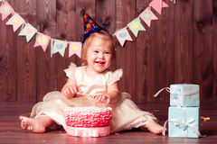Smiling child girl with birthday decorations Stock Images