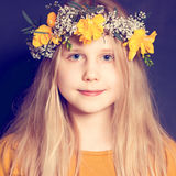 Smiling child girl with flowers Stock Photography