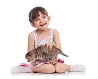 Smiling child girl holding kitten isolated Stock Photography