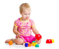Smiling child girl playing with cup toys Stock Images