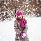 Smiling Child Girl Playing with Snow in Winter Park Stock Image