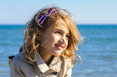 Smiling child girl in raincoat portrait Stock Photography
