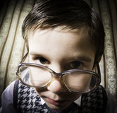 Smiling child with glasses in vintage clothes Stock Image