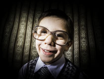 Smiling child with glasses in vintage clothes Royalty Free Stock Photos