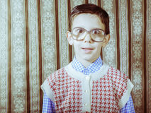 Smiling child with glasses in vintage clothes Stock Photos