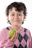 Smiling child with a green apple Royalty Free Stock Photo