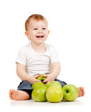 Smiling child with green apples. Adorable child with green apples Royalty Free Stock Photos