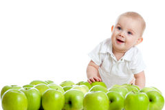 Smiling child with green apples Stock Images
