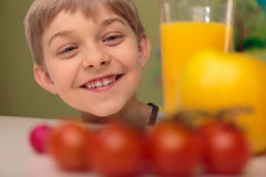 Smiling child with healthy food Stock Photos