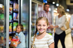 Smiling child with her family Stock Image