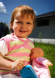 Smiling child with her toys outdoor Stock Images