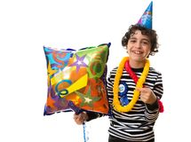 Smiling Child during his birthday party, holding a balloon and over white background Royalty Free Stock Image