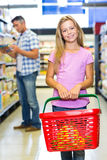 Smiling child holding basket at the supermarket. Portrait of smiling child holding basket at the supermarket Royalty Free Stock Images