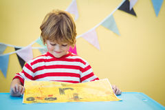 Free Smiling Child Holding His Finished Painting Royalty Free Stock Photography - 62322237