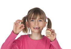 Smiling child holding missing tooth Royalty Free Stock Photo