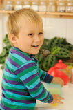 Smiling child in kitchen Royalty Free Stock Photography