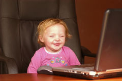 Smiling child with laptop Stock Image