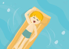 Smiling child on a lilo in a hot summer day Royalty Free Stock Photos