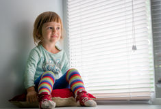 Smiling child looking out the window Royalty Free Stock Image