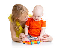 Smiling child and mom playing with musical toy Royalty Free Stock Image