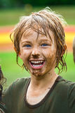 Smiling child with muddy face. Happy, smiling child with muddy face after sport royalty free stock image