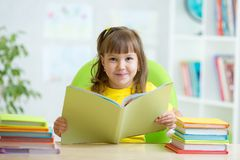 Smiling child with opened book Royalty Free Stock Image