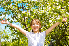Smiling child playing in garden Stock Image