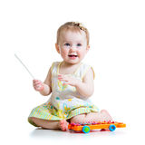 Smiling child playing with musical toy Royalty Free Stock Photos