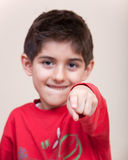 Smiling child pointing Stock Image