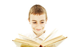 Smiling child reading a book stock images