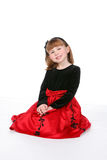 Smiling child in red and black holiday dress Stock Photos