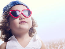 Smiling child with red sun glasses Royalty Free Stock Photos