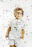Smiling child with rimmed glasses and confetti Stock Photography