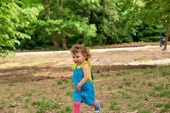 Smiling child running in nature royalty free stock photos