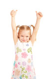 Smiling child showing thumbs up symbol Royalty Free Stock Image