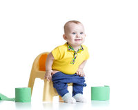 Smiling child sitting on chamber pot with toilet Royalty Free Stock Photo