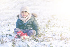 Smiling child in the snow Royalty Free Stock Images