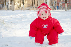 Smiling child on a snowy street Royalty Free Stock Photography