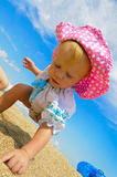Smiling child standing on a beach Stock Images