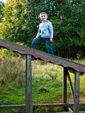 Smiling child standing on the stairs. In a forest Royalty Free Stock Photography