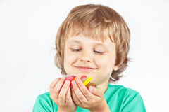 Smiling child with sweets and jelly candies Royalty Free Stock Photo