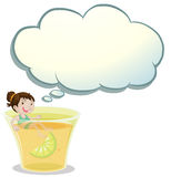 A smiling child swimming on a glass of lemonade Royalty Free Stock Images