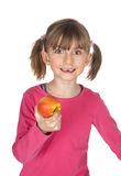 Smiling child with tooth gap and apple Stock Image