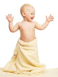 The smiling child in a towel Royalty Free Stock Images