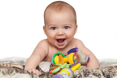Smiling child with toys Royalty Free Stock Photo