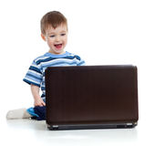 Smiling child using a laptop Royalty Free Stock Photos