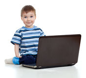 Smiling child using a laptop Stock Photography