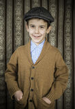 Smiling child in vintage clothes and hat Stock Images
