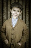 Smiling child in vintage clothes and hat Royalty Free Stock Photography